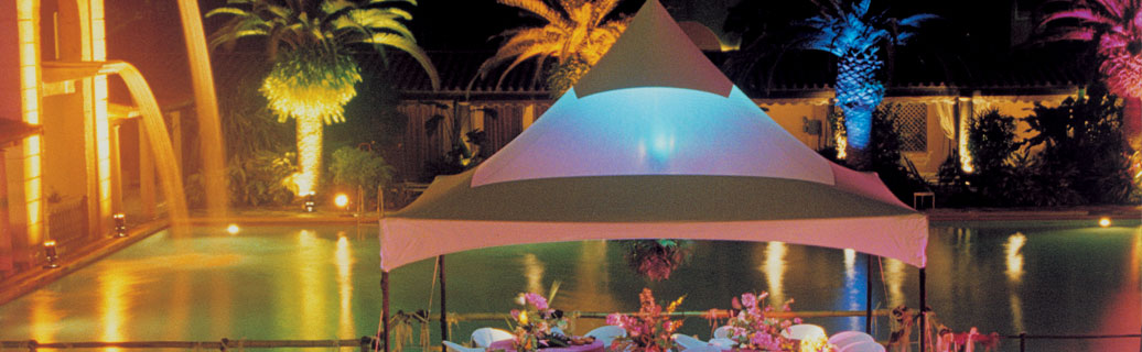 pop up canopy tent beside a pool