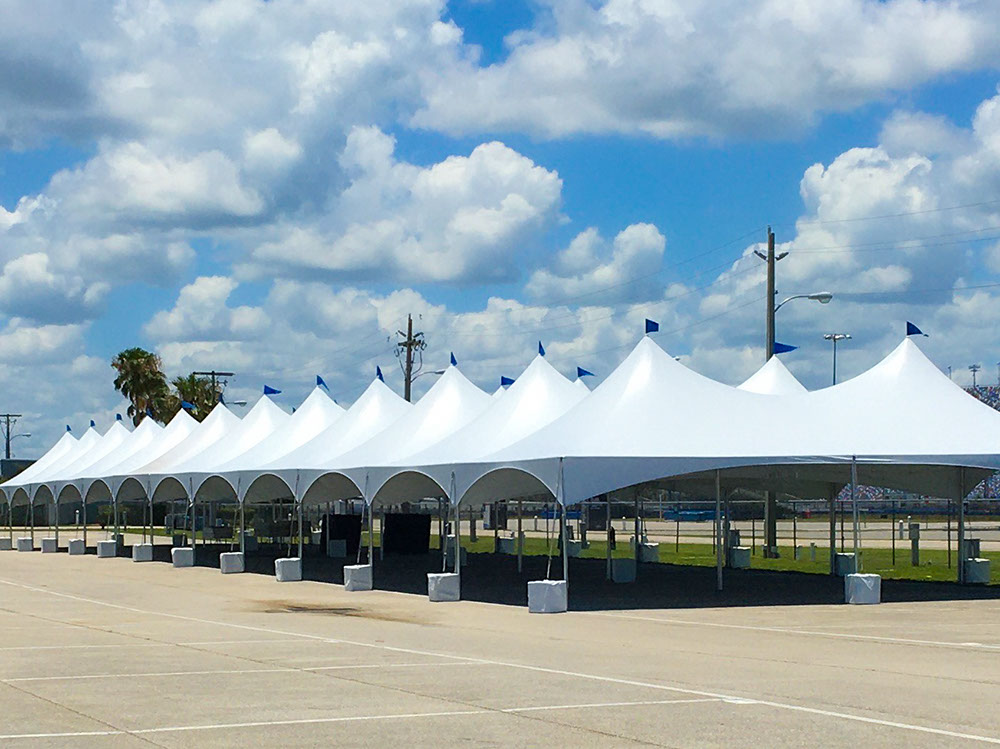 """Tentnology® MQ20x40 with Concrete Ballasts 