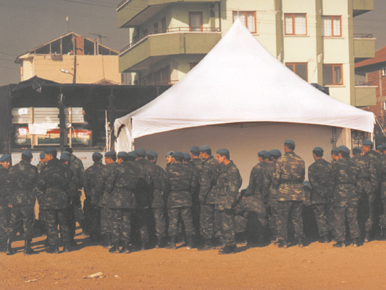 people lined up outside an Emergency Tent